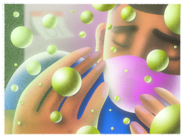 Young man with eyes closed and pink face mask surounded by green bubbles